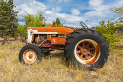 Abandoned tractor. Old abandoned tractor in grass field Stock Photos