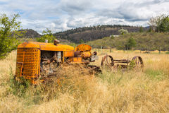 Abandoned tractor. Old abandoned tractor in grass field Royalty Free Stock Photo