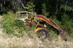 Abandoned Tractor Parked in Overgrown Field. Spain Stock Photography