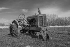 Abandoned tractor. Abandoned tractor rusting in a rural field Royalty Free Stock Images