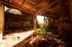Abandoned traditional old stone French cow barn.  stock photography