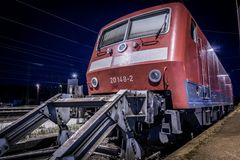 Abandoned train at a dead end at a train station in low wide angle. Shot aside at Karlsruhe train station Germany 2017 Stock Photos