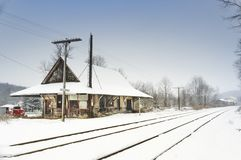Abandoned train depot in winter with snow royalty free stock photo