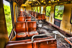 Abandoned train. Inside of a dirty, run-down abandoned train. HDR image Royalty Free Stock Photography