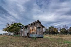 Old wooden house in abandoned train station deep inside south america royalty free stock photography