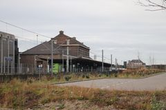 Abandoned train station for rebuild to subway station but delayed in the harbor of Hoek van Holland. Abandoned train station for rebuild to subway station but stock photography