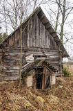 Abandoned triangle canopy entrance to rural wooden house basement Stock Images
