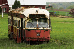 Abandoned trolley car. Old red and yellow, rusted and abandoned trolley car in a farmer's field Royalty Free Stock Photos