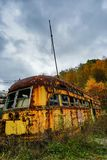 Abandoned Trolley Cars in Fall with Ominous Sky Royalty Free Stock Photo