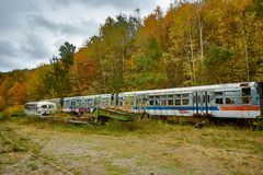 Abandoned Trolley Cars in Fall with Ominous Sky in field with rails Royalty Free Stock Photography