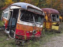 Abandoned trolley cars side on view with broken windows Royalty Free Stock Photography