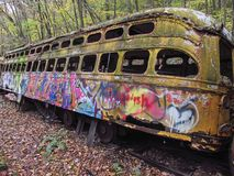 Abandoned trolley cars side view leaning Stock Image