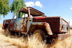 Abandoned truck. Vintage truck abandoned and rusting away in the fields Stock Photo