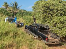 Abandoned truck on Kauai beach being towed royalty free stock photos