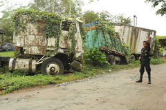 Abandoned truck wreck and train wagon at Quirigua Stock Photo