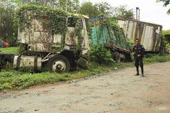 Abandoned truck wreck and train wagon at Quirigua Royalty Free Stock Photos