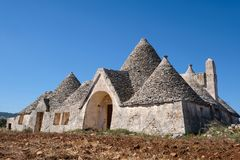 Free Abandoned Trulli House With Multiple Conical Roofs Located In A Field In The Area Of Cisternino / Alberobello In Puglia, Italy Royalty Free Stock Photo - 130468955