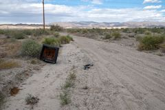 Abandoned TV left to rot in the middle of the California desert, taken near the Salton Sea.  stock photography