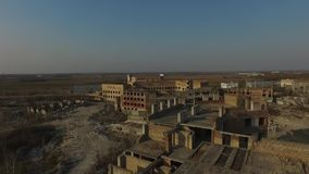 Abandoned construction site of Hospital at spring time aerial drone image. Abandoned at 1991,during Ukrainian undependence crisis.Near Kiev,Ukraine stock video footage