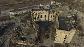 Abandoned construction site of Hospital at spring time aerial drone image. Abandoned at 1991,during Ukrainian undependence crisis.Near Kiev,Ukraine stock video