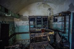 Abandoned underground Soviet communication bunker with remnant of equipment.  royalty free stock photos