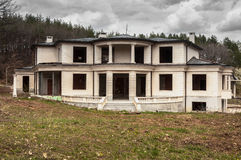 Abandoned unfinished big modern house. In suburban area Royalty Free Stock Photography