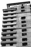 Abandoned Unfinished Building. Unfinished building, vertical shot in black and white Stock Photo