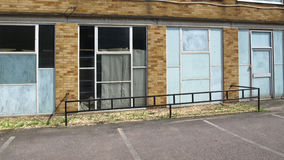 Abandoned units. Photograph of abandoned retail units, street scene from a derelict industrial estate Royalty Free Stock Image