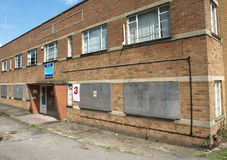 Abandoned units. Photograph of abandoned buildings, boarded up, taken on derelict light-industry industrial estate Stock Photos