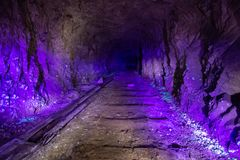 Abandoned uranium mine illuminated by ultraviolet light.  royalty free stock image