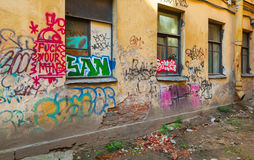 Abandoned urban courtyard with abstract graffiti Royalty Free Stock Photography