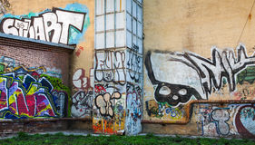 Abandoned urban courtyard with abstract graffiti Stock Photos
