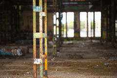 Abandoned vandalised dirty industrial ruin inside Stock Photo