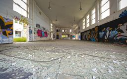 Abandoned vandalized office building. Αbandoned, vandalized office building interior. Broken glass at the foreground Stock Image
