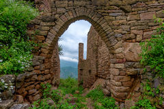Abandoned village Gamsutl in Dagestan. Scenic landscape with ruins of lost city in mountains Stock Photo