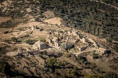 Abandoned village of Occi and the coast of Corsica Stock Photos