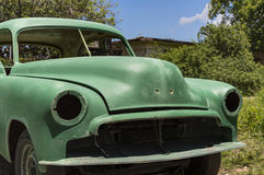 Abandoned vintage car in Cuba. Front view of a green american old car in Cuba royalty free stock image