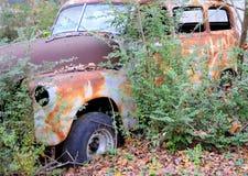 Abandoned vintage car. Stock Photos