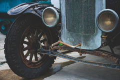 Abandoned vintage car wheels and headlight - Classic vehicles Stock Photography