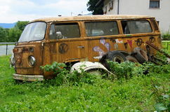 Abandoned Volkswagen Transporter Camper. Radovljica, Slovenia - August 7, 2017: Old rusting abandoned Volkswagen Transporter Camper. Nobody in de vehicle royalty free stock photo