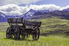 Abandoned Wagon near the Rocky Mountains. Abandoned Wagon in a field near the rocky mountains of southern Alberta Canada Royalty Free Stock Images