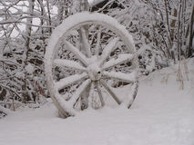 Abandoned wagon wheel. In the snow, Quebec, Canada Stock Images