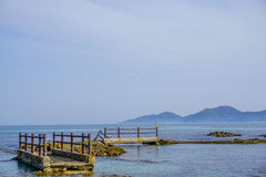 Abandoned walkway with background of the ocean in Japan. Royalty Free Stock Images