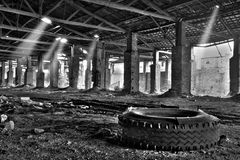 Abandoned warehouse. Interior of abandoned warehouse (black and white HDR photo royalty free stock photography