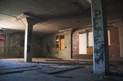 Abandoned warehouse. Abandoned, graffiti filled warehouse in a dangerous part of the city stock images