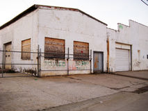 Abandoned Warehouse. An abandoned warehouse with windows boarded up Royalty Free Stock Images