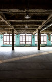 Abandoned warehouse at factory with long hallway and big windows Royalty Free Stock Photography