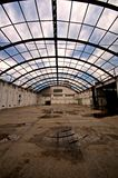 Abandoned warehouse. An abandoned warehouse of a factory with no roof and wet floor Stock Photo