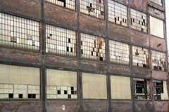 Abandoned warehouse. Abandoned industrial warehouse with broken windows Royalty Free Stock Image