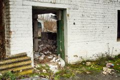 Abandoned warehouse and industrial buildings and buildings. Are covered with garbage and overgrown with bushes and grass Royalty Free Stock Photos